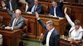 Lawmakers strike deal on schools, pandemic bonuses