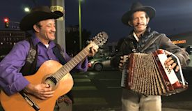 Immigrant street musicians turn adversity into art to earn their daily bread
