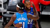 Newly minted champions, Milwaukee Bucks' stars Khris Middleton and Jrue Holiday head to Olympic Games