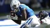 The Latest: Campbell catches TD pass, injures foot for Colts