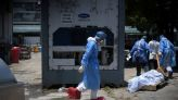 Ecuador stores coronavirus victims in giant fridges as morgues fill up