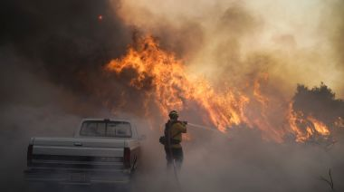 Wildfires explode in California, forcing more than 60,000 evacuations