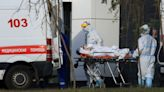 Russian healthcare system feels the strain as daily COVID-19 deaths break record