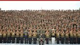 """China's Xi vows to """"defend"""" and """"develop"""" North Korea ties as Kim rallies army"""