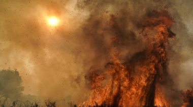 AP PHOTOS: Wind-whipped wildfires clobber California again