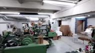 Watch Latvian police 'bust an illegal cigarette factory'