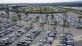Travelers wait long lines, pay more as global microchip shortage cuts new car production, deals blow to car rental companies
