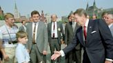 Former White House photographer shares picture of 'young Putin spying on Ronald Reagan' in 1988