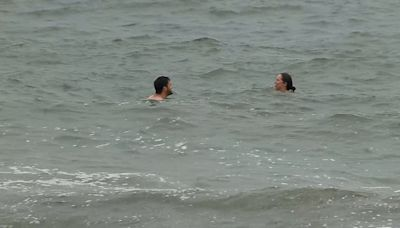Swimmers take dip in ocean off Cape Cod before rain, wind intensify with nor'easter