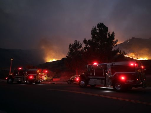 Firefighters battle to save Orange County subdivisions as flames march closer