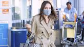 Angelina Jolie Brings Back Airport Style with a Dior Trench Coat and Oversized Celine Tote Bag
