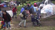 Hundreds of Venezuelans camp beside Bogota highway amid pandemic