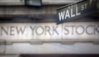 Dow, S&P futures rise as Fed stays dovish course; Ford jumps
