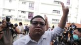 Thai protest leaders hear police charges of defaming king