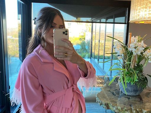 Pregnant Katharine McPhee Wears Pink Outfit While Cradling Baby Bump to Show Off 'What's in the Oven'