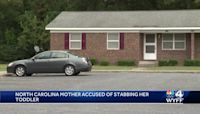 North Carolina woman charged for stabbing 1-year-old in front of officer, police say