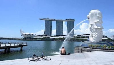 信報即時新聞 -- 新加坡收緊防疫限制 堂食周一起減至兩人
