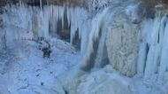 Minnehaha Falls Remain Frozen as Fresh Snow Falls in Minneapolis