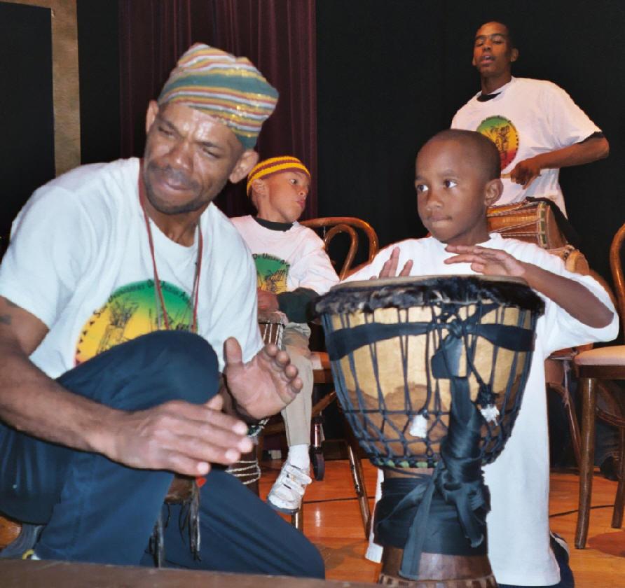Tacuma King Leading Children in Flight in Performance