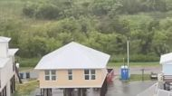 Children Splash Around Tropical Storm Elsa Floodwaters in Gulf Shores