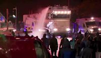 Police fire water cannons at Belfast protesters