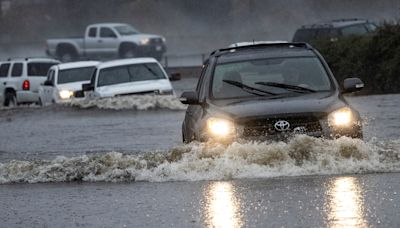 Record storm slams West Coast as tens of millions on East Coast brace for nor'easter