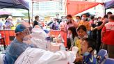 China sees highest daily coronavirus cases in current outbreak