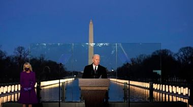 Biden and Harris lead Lincoln Memorial vigil for Covid victims as US death toll passes 400,000