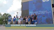 A banner of John Schlarman at Kroger Field