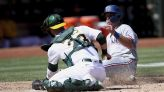 Rangers score five in 8th, come back to nip A's 8-6