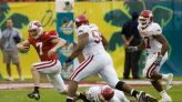 Wisconsin football faces Arkansas in the latest USA TODAY bowl projections