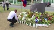 Haitians protest, pay tribute to president