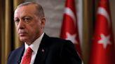 Turkish President Tayyip Erdogan sits during an interview with Reuters in Manhattan, New York