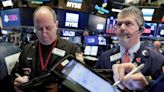 Nasdaq climbs to second straight record, Dow, S&P little changed