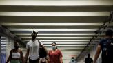 U.S. urges vaccinated Americans to wear masks indoors in many places