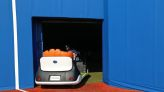 Olympics-Baseball-Toyota's cute 'relief' cart gets mixed player reviews