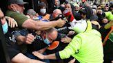 Covid: Melbourne construction sites shut after violent vaccine protest