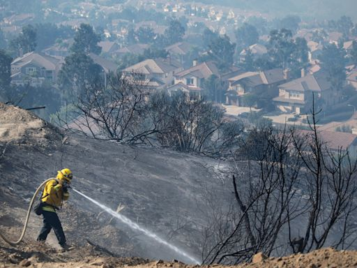 In California: Fires blaze in the OC; wear a mask while cheering the Dodgers