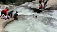 A hiker trapped in a whirlpool was rescued by an off-duty officer using a cord from his backpack