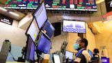 Stock Futures Waver Ahead of Earnings, Data