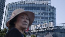 Evergrande: Crisis-hit firm strikes China debt deal