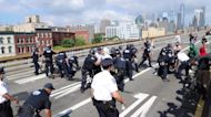 Arrests and tensions as police supporters and Black Lives Matter protesters clash on Brooklyn Bridge
