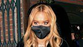 Rita Ora Makes a Statement in a Black Velvet Suit & the Wildest Twist on Socks & Sandals