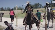 Border patrol agent seen holding whip during encounter with Haitian migrants