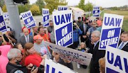 Deere gets temporary injunction limiting striking worker picket line -Iowa court