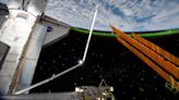 Astronauts install solar panels on ISS