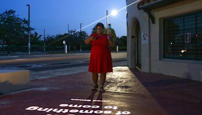 Walking around Opa-locka City Hall at night? You may see a projected poem
