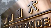 China Evergrande lines up funds to pay interest, avert default -source