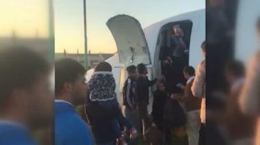 Iran passenger plane skids off runway onto road