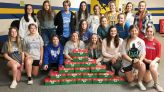 Mantachie's volleyball and softball team packs Christmas boxes
